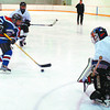 3-on-3 minor hockey in monday dave milne april 2 04 3-on-3 hocke Ice Reapers shoot on Dream Team goalie Dylan Long.