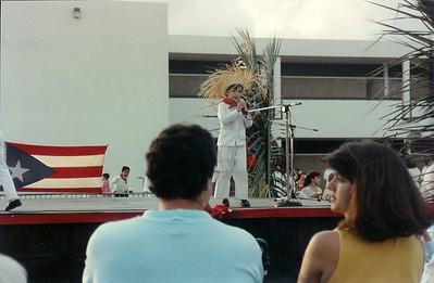 Dan sings a song dressed as a Jíbaro on Puerto Rican Night