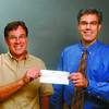Yellowhead Rotary Ski Nationals/Friday Brent Braaten-Aug 12/2004  Cal Benson , event Co-Chair 2005 Ski Nationals , accepts a cheque for $20,00 from Rick Turgeon president of the Yellowhead Rotary Club. The money will be used for a expansion of the lodge at Otway Nordic Centre.