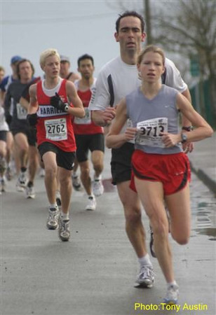 2004 Bazan Bay 5K - Stephanie Mills probably isn't sheltering this fellow very much from the wind