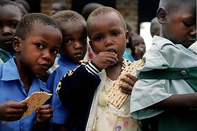 Abayudaya Children Eating Matzo
