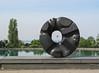 "In front of the Asian Art Musuem, Isamu Noguchi's granite ""Black Sun"", framing the Space Needle"