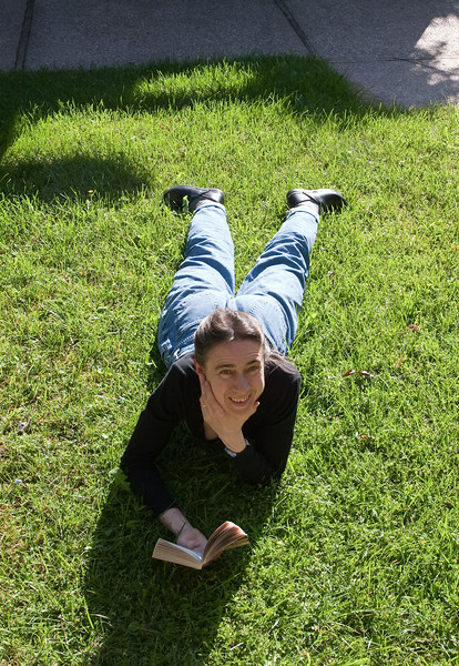Chantal reading in the grass