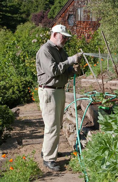 Grandpa Edmund watering