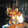 Mama Devorah and granddaughters Simcha, 8, and Deborah, 4, light Chanukah candles in Abayudaya community, Budi Zone, near Mbale, Uganda, 2002.