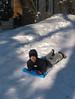 Benjamin sliding down the driveway