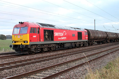 60007 'The Spirit of Tom Kendell' 1600/6E38 Colnbrook-Lindsey passes Ayres End Lane, Harpenden 07/11/12.