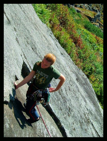 Unusually sunny weather smiles on Lisa Thorson, climbing <i>Snowflake 5.8</i> in Reed Valley.