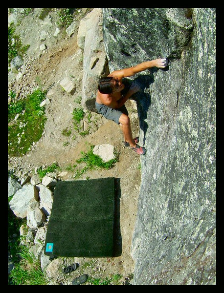 Joe Ramos pulls the moves on a boulder near the road in Archangel Valley.