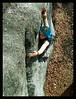 Tim Ponomorev pulls down on sloper on the Service Boulder in Anchorage.