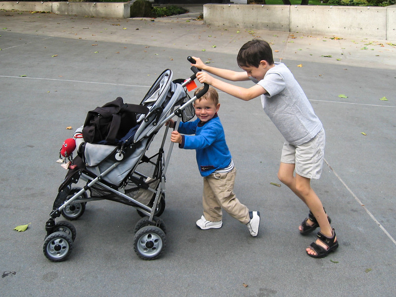 Joey and Benjamin pushing stroller
