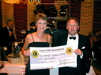 Isle of Axholme Lions member Terry Condliff, presents chairman of the Haxey school Ball committee Gill Etherington, with a cheque for £100. This was sponsorship for a table at the Haxey C of E primary school Summmer Ball,held at Epworth Leisure centre, at which over £2,000 was raised for the school's PTA.