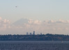 """The Mountain is out"": Mt. Rainier behind Seattle skyline, with floatplane"