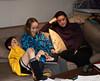 Benjamin, Isabel, and Marian watching TV: Red Sox winning World Series