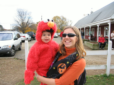 October 31 2004 photos (Hailey dresses as Elmo for Halloween. She has fun as the McCray Farm, going on a hay ride and going to the petting zoo. Then she goes Trick or Treating.)