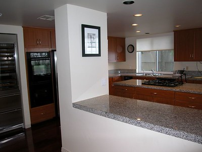 The breakfast bar and kitchen