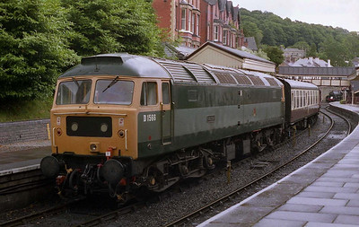 Repainted into two-tone green livery and named 'Orion' since my last visit several years previously, 47449 wait to depart LLangollen with the 1300 to Carrog during the railway's Diesel Weekend (03/07/2004)