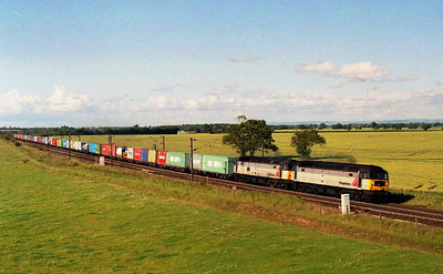 And now for something completely different: 47358+47303 'Freightliner Cleveland' shatter the afternoon tranquility at Colton as they head south along the ECML with 4L79 1607 Wilton-Felixstowe. At the time these were two of Freightliner Intermodal's last t