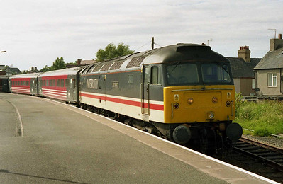 Due to a succession of loco failures the previous day, there were insufficient '47s' for the Chester shuttles to be top-and-tailed, so 47826 worked its trains alone and ran round at either end. 'Springburn' is seen here waiting time at Llandudno Junction