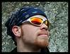 John Saari's glasses reflect a hint of the Alaskan splendor he's looking at near Chickaloon.