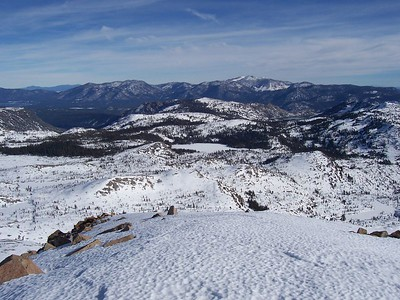 The tip of Lake Tahoe can be seen on the left.  The frozen spot in the center is Lake of the Woods.  Freel Peak in the distance.