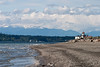 Down on the beach, with the lighthouse in the distance, and the Olympics across Puget Sound