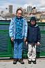 On the Bainbridge ferry: kids in front of the Seattle skyline