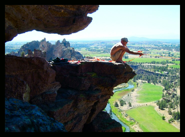 Shawn Snyder and the farm fields of Terrebonne, during setup of the longer line at the Monkey Face, Smith Rock, Oregon.