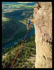 """Metolius"" Shawn Snyder almost halfway across the new long line at the Monkey Face, Smith Rock, Oregon."