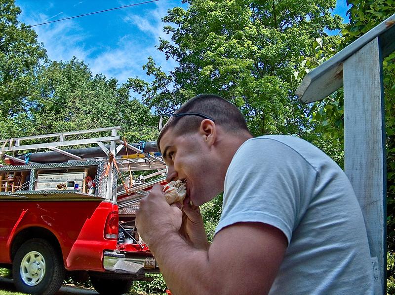 Caleb eating a sandwich