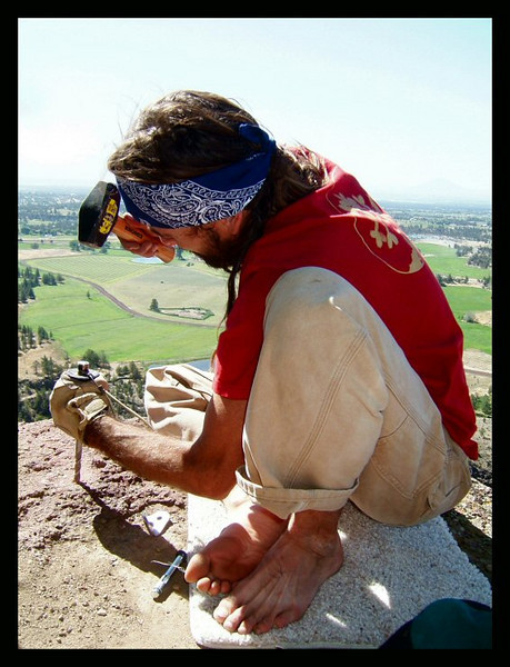 """Metolius"" Shawn Snyder installs an anchor for a bold new highline on the Monkey Face, Smith Rock, Oregon."