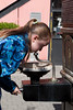 Isabel taking a drink at a fanciful water fountain