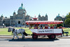 Horse-drawn tourist wagon in front of Parliament
