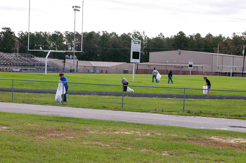 Teachers help get field ready