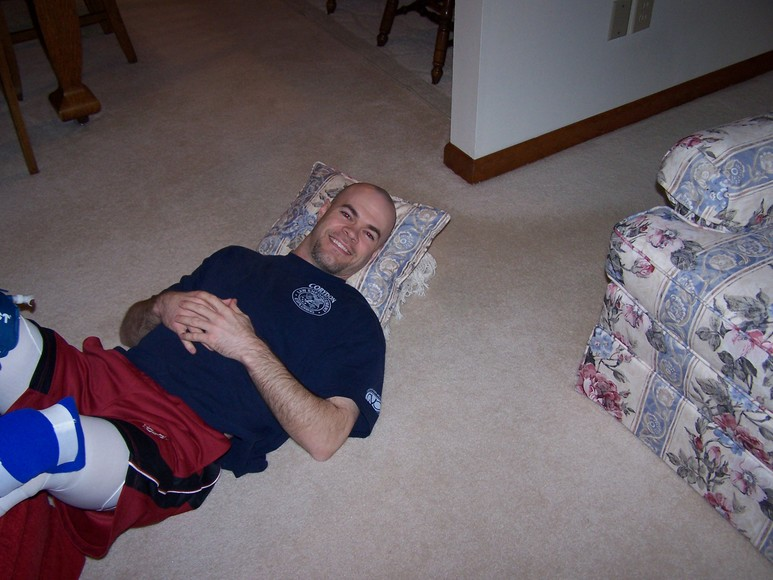 Christmas day at my parents...keeping those knees elevated and iced!  Boy that routine got old!  I'm laying beside the Christmas tree ready to unwrap stuff.