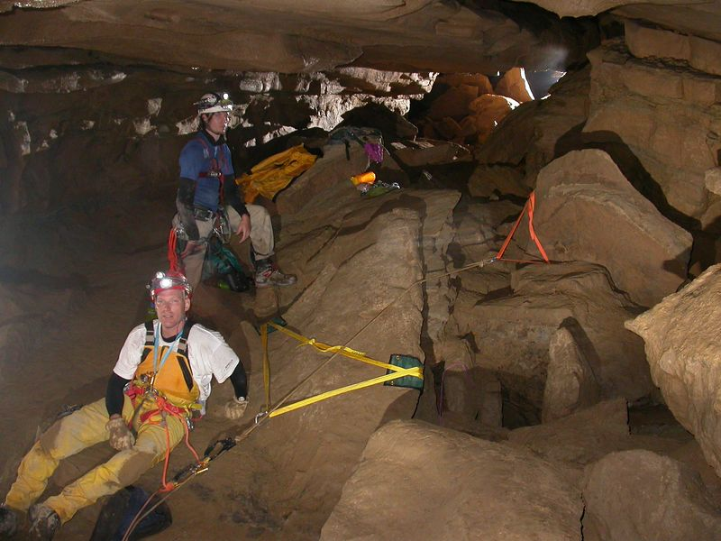 This area at the top of the pit is referred to as the Attic.  We rigged indirectly to two different boulders.