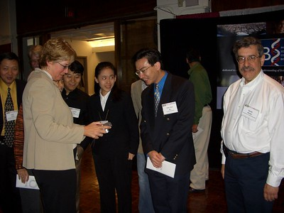 BJ Morrison-McKay and David Rocke with ISCB travel fellowship recipients at RECOMB 2005.