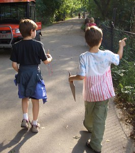 David and Sam orienteering.  Sam is pointing at a path he was hoping to get to walk on, and he did.