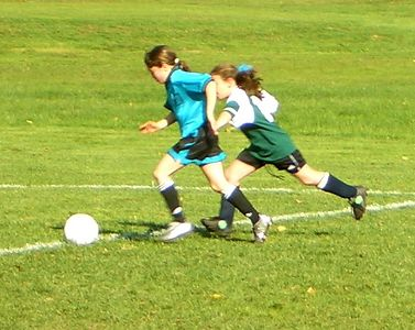 Danielle driving the ball downfield