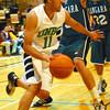 unbc langara basketball in saturday dave milne feb 18 05 Raju Korotana, 11,  moves around Mike davis, 5, and Anthony Lao heading for the basket.