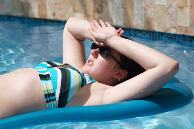 Liz now relaxes IN the pool