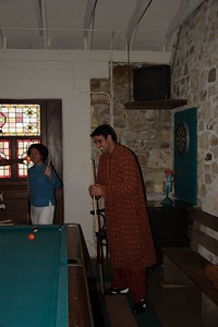Anshul playing pool with friends before his wedding ceremony (This was the third ceremony of his wedding, so he is cool.)