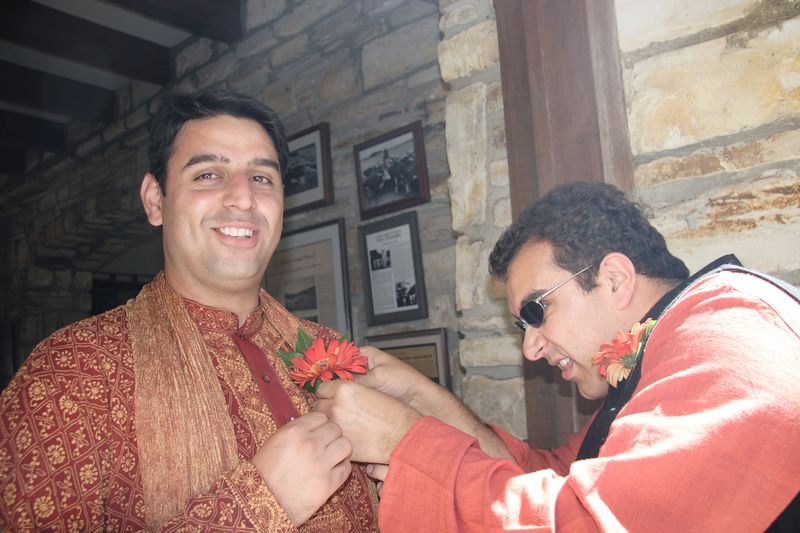 Sameer trying (unsuccessfully) to attach the flower to Anshul's jacket