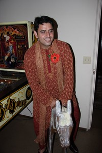 Anshul riding a horse at his wedding. It is a part of the Indian wedding tradition. Well, they usually use a real horse in India.