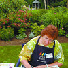 Artist in The Garden/Monday Brent Braaten-July 17/2005  Vi Martens works on a painting in a garden on McGrath Place Sunday aftertnoon during the thirs annual Artists in the Garden fund raising event for the Two Rivers Gallery.
