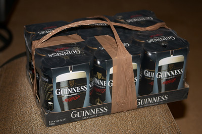 Henry arrives bearing a case of Guinness