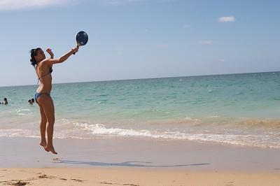 Michelle plays paddleball