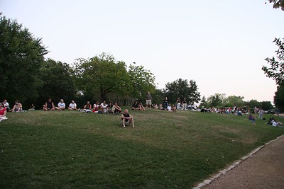 People gathered to watch the bats flying from under the bridge at dusk
