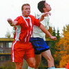 Action2/Soccer Page/Tuesday Brent Braaten-Sept 18/2005  Tresure Cove Tony Gosselin and Honda North/Citizen Eric Hoarin go fo the ball.