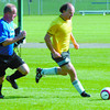 Action6/Soccer Page/Tuesday Brent Braaten-Sept 18/2005  Brink player Don Kehlerchases  Subway player Rob Ksyniuk during Division three players.